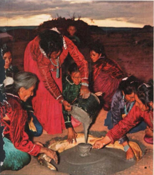 Pouring Corn Batter for the ceremony cake (alkaan) Kinaaldá, the Navajo Puberty Ceremony