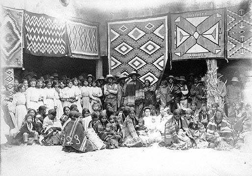 Shiprock Fair 1913 - Navajo men, women and children with Navajo Rugs