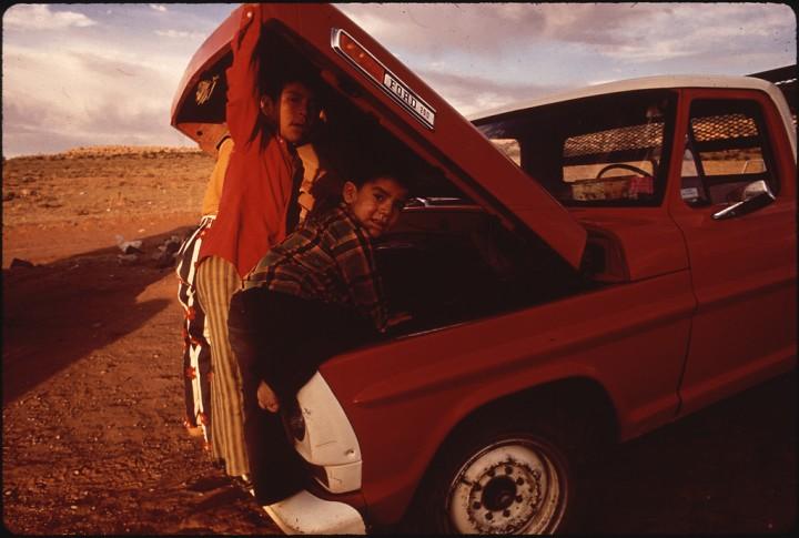 Navajo Children Examine Their Family Pick-Up Truck