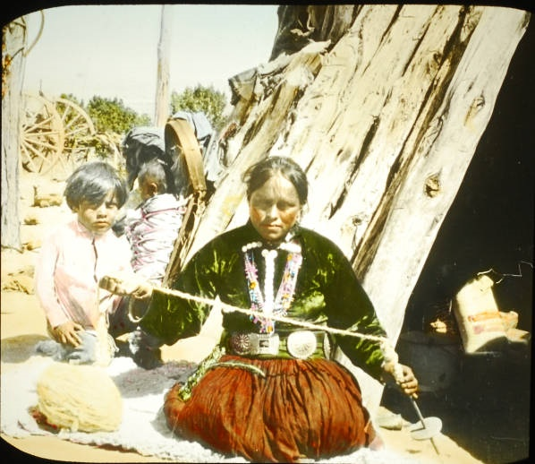 Navajo Woman Weaver with Child Spinning  Wool