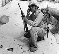 Navajo Code Talker in the South Pacific, November 1943. U.S. Marine using walky-talky