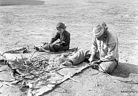Navajo Indians working on hides