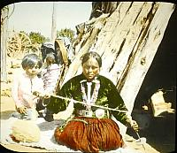 navajo woman weaver with child