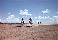 Indian Race. Two white horses, ridden by young Navajo women