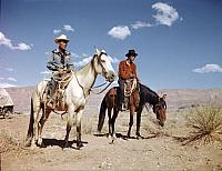 Navajo Horsemen. Two young Navajos sit on their mounts