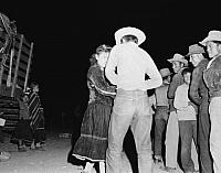 Navajo Gatherings and Dances Navajo Rodeo Squaw DanceGirl grabs one of the singers Caption by Josef Muench