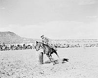 Navajo Rodeo at Marble Canyon and Rough Rock Barrel Race 1 Rider Caption by Josef Muench