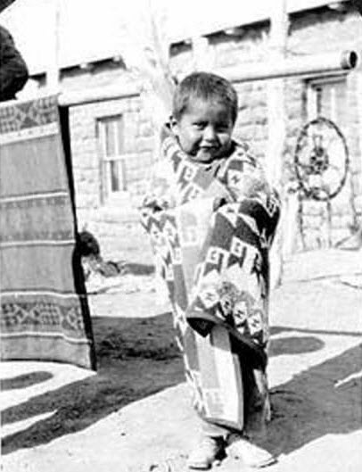 Sweet enough to kiss! Little Navajo boy wrapped in a Pendleton blanket